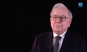 A picture of Warren Buffett with a black background