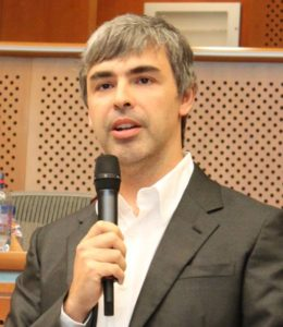 Picture of Larry Page speaking into a handheld microphone