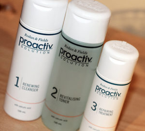 Picture of three bottles of personal cosmetic beauty products