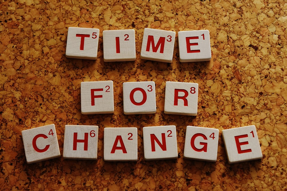 """Letter tiles spelling out """"Time for Change."""""""