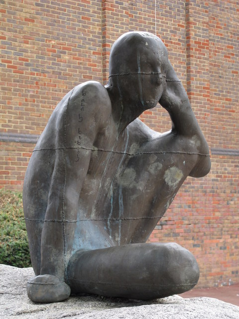 "A picture of Antony Gormley's statue ""Untitled [Listening],"" Maygrove Peace Park."
