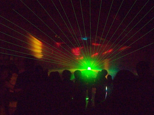 A picture of an audience at a laser show.