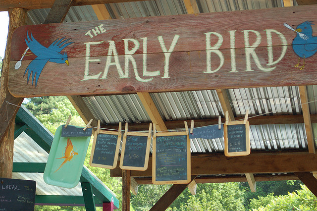 "A picture of a sign that says ""the early bird."""