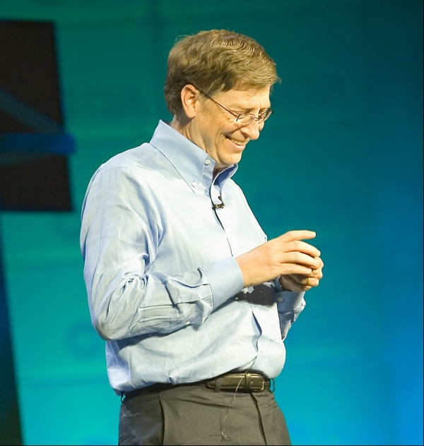Bill Gates speaking on a stage.