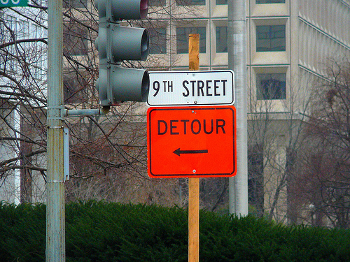 A traffic detour sign