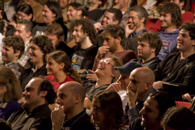 An audience reacts to a speech.