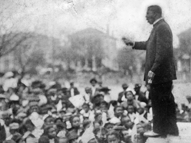 Booker T. Washington delivers the Atlanta Compromise speech.