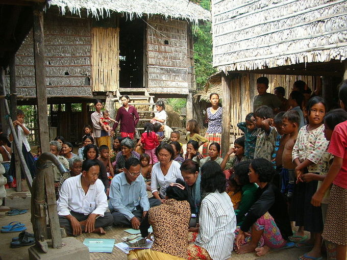 An oral community in Takéo, Cambodia sits together and discusses a writing.