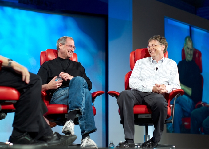 Photograph of Steve Jobs and Bill Gates sitting on a stage together.