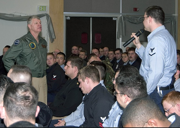 Damage Controlman 3rd Class Mark Gorley asks Adm. Gary Roughead a question during a Q&A session.