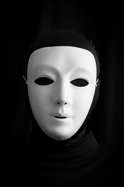 A picture of a person dressed in black spandex. All that's visible is a white face mask.