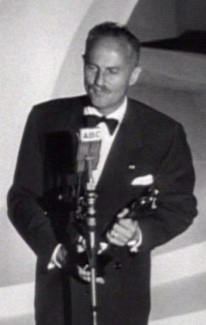 American film producer Darryl F. Zanuck accepts an Academy Award for his work.