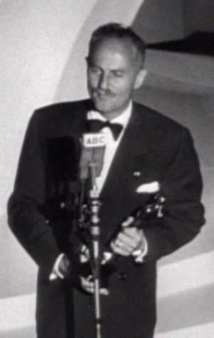 American film producer Darryl F. Zanuck accepts an Academy Award for his work.