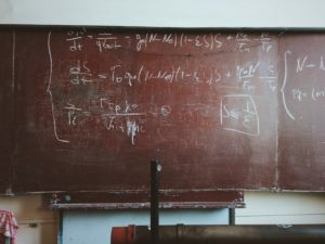 Old chalkboard with math equations.