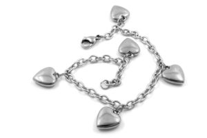 Image of a silver chain charm bracelet with five silver heart charms.