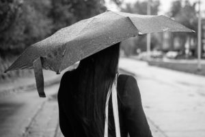 Photo of a woman with an umbrella.