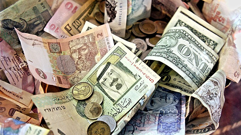 Money from various countries in a pile.