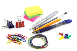 Picture of office supplies like pencils, paper clips, sticky notes, rubberbands, etc.