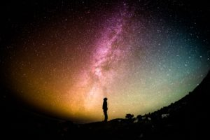 Person appearing reflecting, looking up at the night sky.