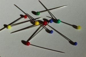 Sewing pins on a white background.