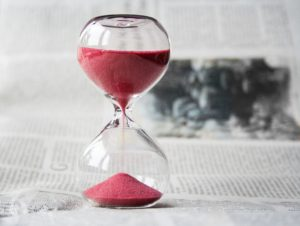 Hour glass with red sand.