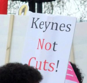 "A homemade sign saying ""Keynes Not Cuts!"""