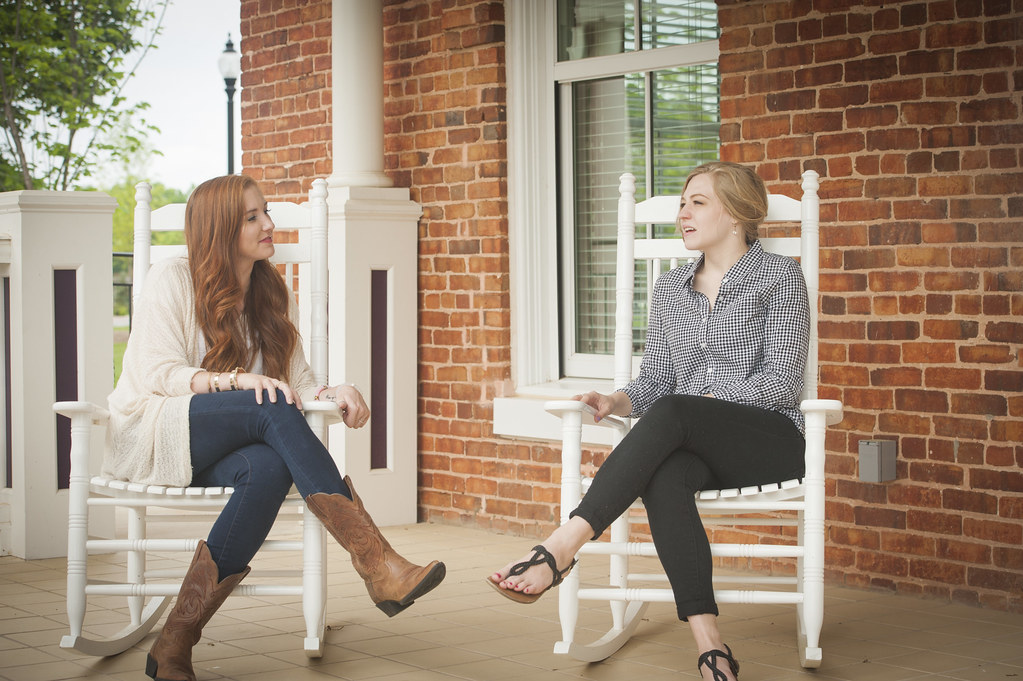 Students talking on a porch