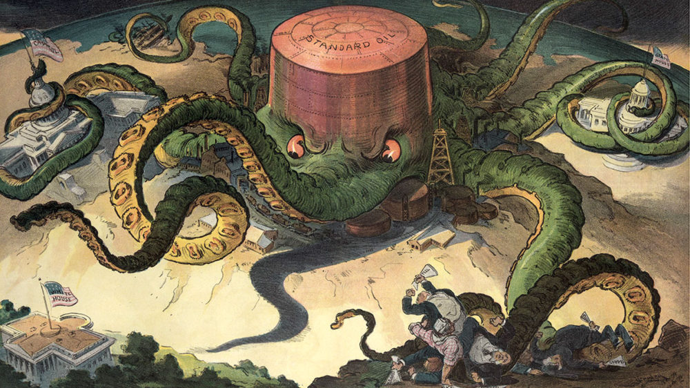 """Cartoon showing an octopus with a head that reads """"Standard Oil"""" with its tentacles controlling people, the white house, and the capitol building."""