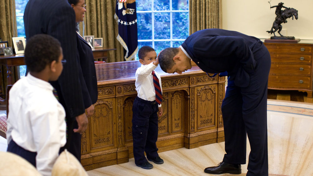 5-year old boy touches Obama's hair in the Oval Office.