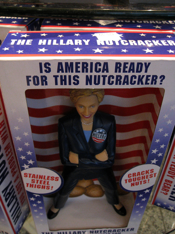 "A toy figure of Hilary Clinton is shown in a packaging box reading ""Is America Ready for This Nutcracker?"""