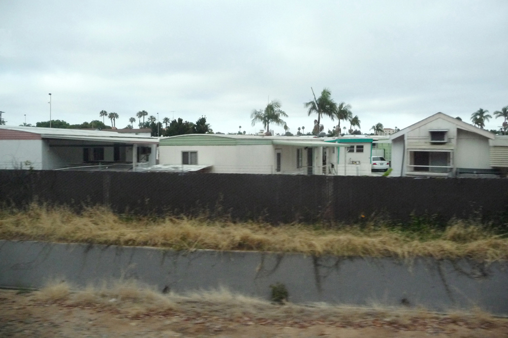 Figure (b) is of a mobile home park.