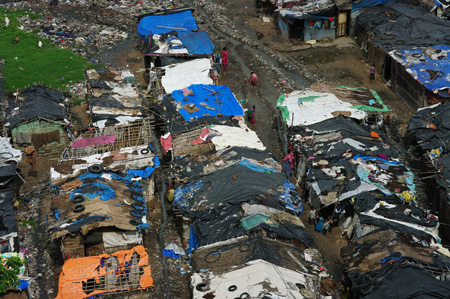 Dilapidated slum dwellings are shown from above.
