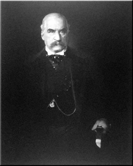 In figure (b), a photograph of J.P. Morgan is shown.