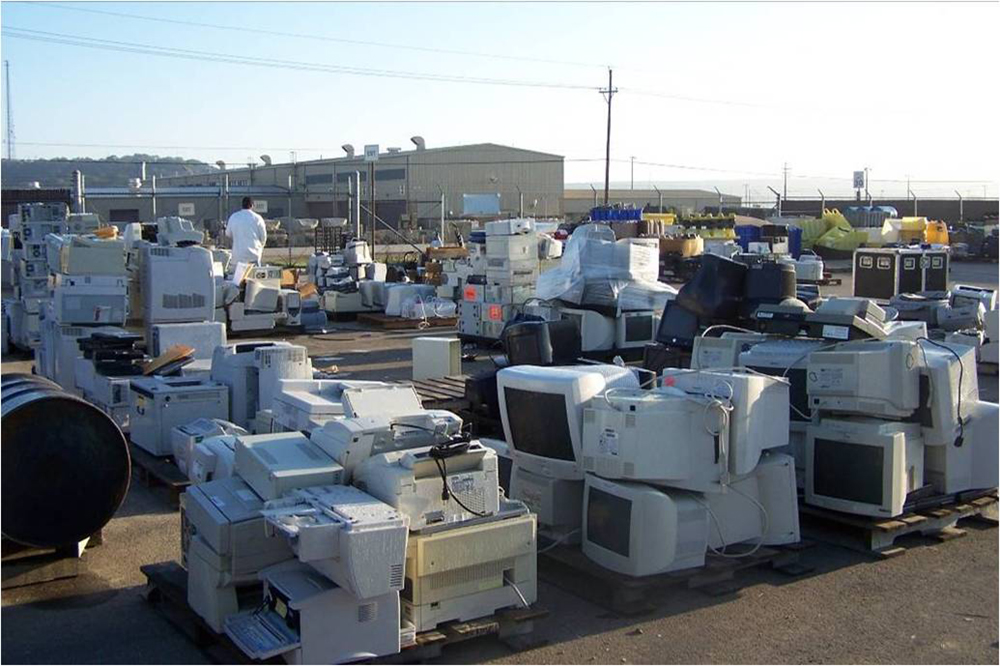 A lot filled with computers and other old electronics is shown here.