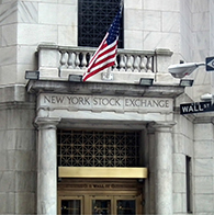 The image is a photograph of the New York Stock Exchange's entrance