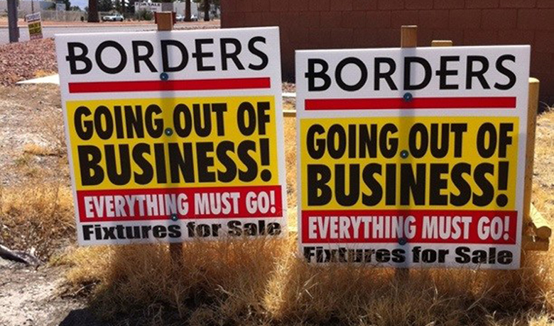 "This image is a photograph of a ""Going Out of Business"" signs for Borders. The signs denote that even the fixtures are for sale."