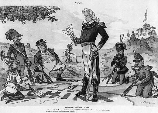 "A cartoon captioned ""Putting His Foot Down"" shows Uncle Sam standing on a map of China, while Europe's imperialist nations (Germany, Spain, Great Britain, Russia, and France) try to cut out their ""sphere of influence"" using large scissors. Austria sharpens its own scissors in the background. Uncle Sam holds a document labeled ""Trade Treaty with China"" and says, ""Gentleman, you may cut up this map as much as you like, but remember, I'm here to stay, and you can't divide Me up into spheres of influence."""
