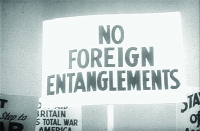 "A protest sign reads ""NO FOREIGN ENTANGLEMENTS."""