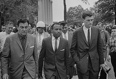 A photograph shows James Meredith entering the University of Mississippi, flanked by a U.S. marshal and the assistant attorney general for civil rights.