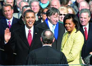 A photograph shows Barack Obama taking the oath of office beside Michelle Obama.