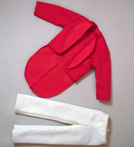 Photo of hand-made Ken doll clothes, a red tuxedo jacket and white pants.