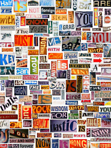 Color photo of words cut from magazine articles, posted on a wall. The colors and typefaces vary among words.