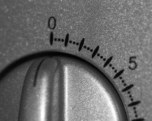 Close-up photo of a silver microwave dial timer