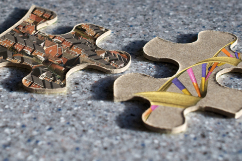 Two jigsaw puzzle pieces are shown; one depicts images of houses, and the other depicts a helical DNA strand.
