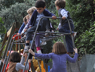 A photograph shows children climbing on playground equipment.