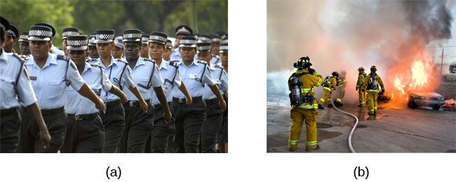 Photograph A shows uniformed police officers marching with synchronized arms swinging. Photograph B shows firefighters fighting a fire.