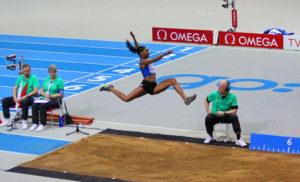 Eloyse Lesueur performing long jump in 2013