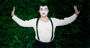 Pictured is a Mime actor.