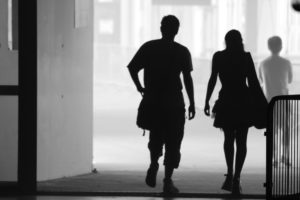 """While the biological differences between males and females are fairly straightforward, the social and cultural aspects of being a man or woman can be complicated. (Photo courtesy of """"man and woman silhouettes""""byFred Bchxis licensed underCC BY 2.0)"""