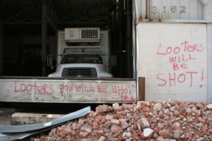 A sign warns looters they will be shot